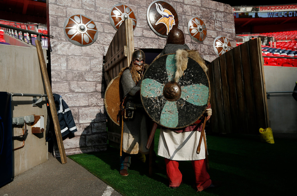 . Stadium personnel dressed as vikings stand at a make shift entrance to field at Wembley Stadium before the NFL football game between the Pittsburgh Steelers and Minnesota Vikings in London, Sunday, Sept. 29, 2013.  (AP Photo/Matt Dunham)
