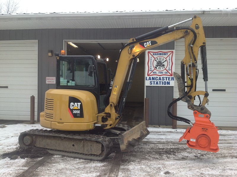 NPK C3D compactor with backfill blade on Cat mini excavator (7).JPG