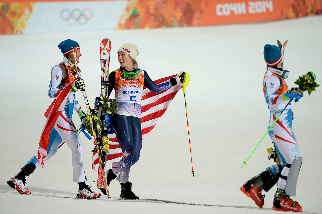. Gold medalist American Mikaela Shiffrin (center) jokes with silver medalist Marlies Schild of Austria (left) as they walk to the podium with bronze medalist Kathrin Zettel of Austria after ladies\' slalom run 2. Sochi 2014 Winter Olympics on Friday, February 21, 2014 at Rosa Khutor Alpine Center. (Photo by AAron Ontiveroz/ The Denver Post)