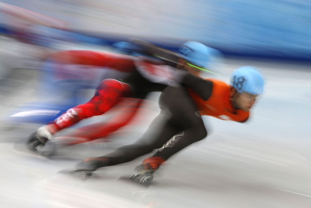 . Netherlands\' Sjinkie Knegt (R) and Canada\'s Olivier Jean compete in the Men\'s Short Track 1000 m Heats at the Iceberg Skating Palace during the 2014 Sochi Winter Olympics on February 13, 2014. ADRIAN DENNIS/AFP/Getty Images