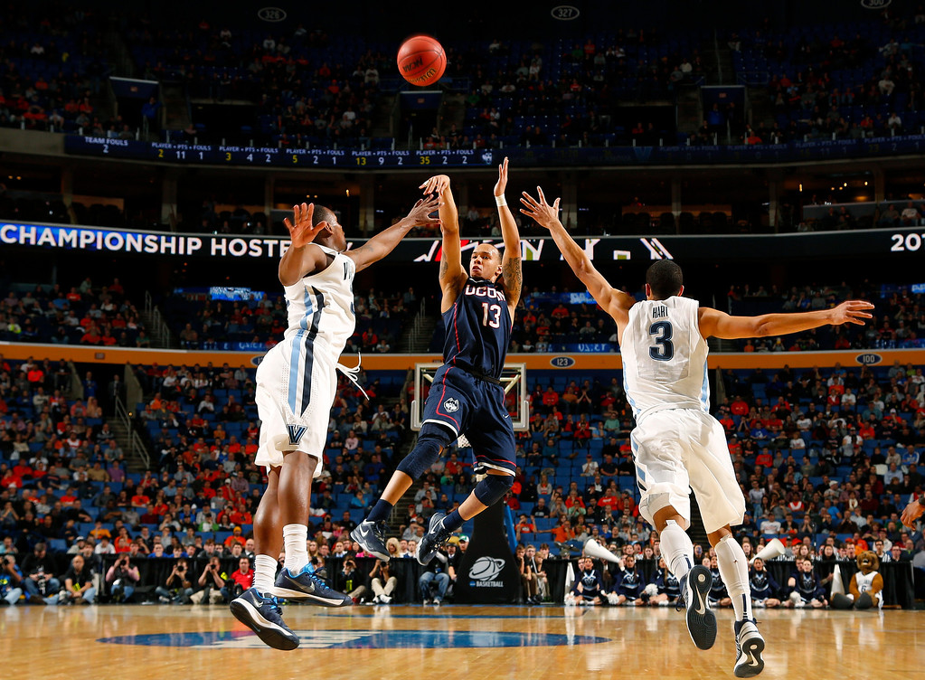 . Villanova\'s Josh Hart (3) runs out to defend Connecticut\'s Shabazz Napier (13) during the second half of a third-round game in the NCAA men\'s college basketball tournament in Buffalo, N.Y., Saturday, March 22, 2014. (AP Photo/Bill Wippert)