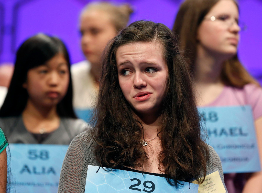 . Colorado student Eva Kitlen, of Niwot, shows her nervousness in the semi-final round of the 2013 Scripps National Spelling Bee at the Gaylord National Resort and Convention Center at National Harbor in Maryland, May 30, 2013.   REUTERS/Larry Downing