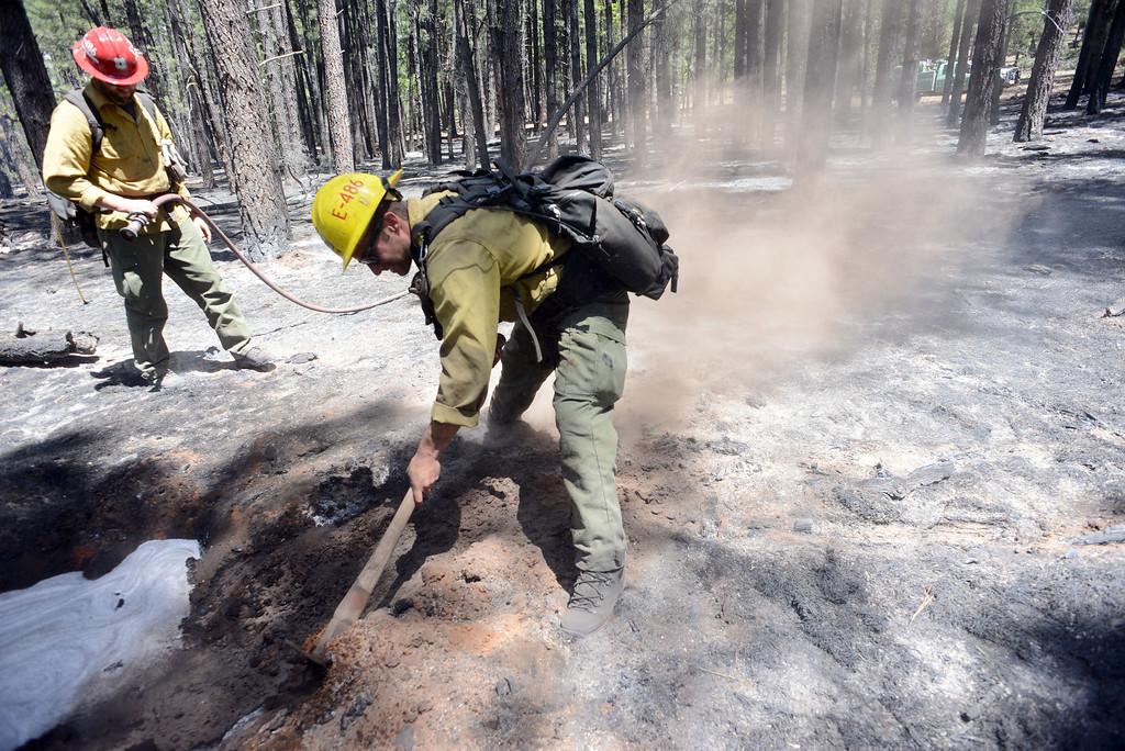 . U.S. Forest Service firefighting crews work hotspots Thursday May 22, 2014 near Sedona, Ariz .The human-caused Slide Fire started Tuesday. (AP Photo/ Vyto Starinskas)