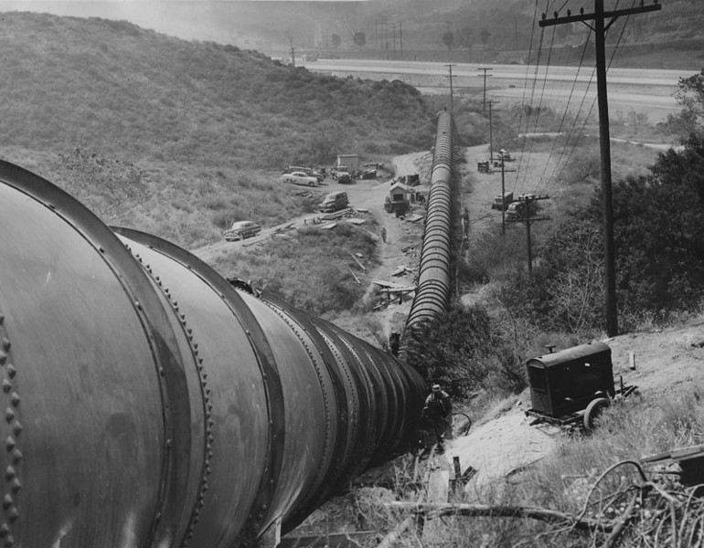 . Los Angeles Aqueduct pipe line runs down hill and under the new freeway on June 25, 1955   (Los Angeles Public Library)
