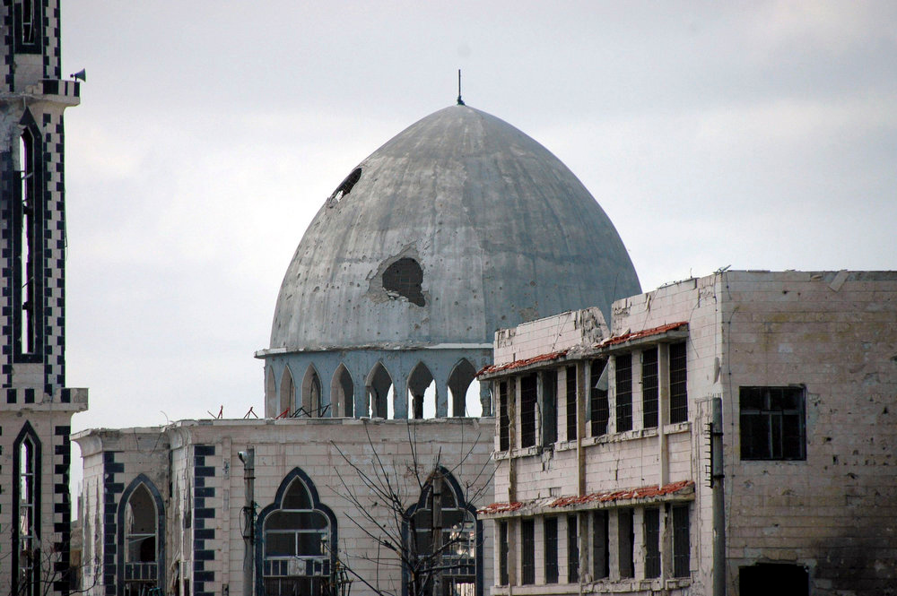 . A view is seen of a damaged mosque at Baba Amro neighborhood in Homs city, after clashes between forces loyal to Syrian President Bashar al-Assad and fighters of the Free Syrian Army,is seen in this handout photograph distributed by Syria\'s national news agency SANA on March 27, 2013. REUTERS/SANA/Handout
