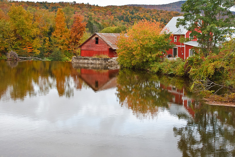 Red barns create colorful reflections on the Little River, near Moscow. (photo by Kerry Brooks)