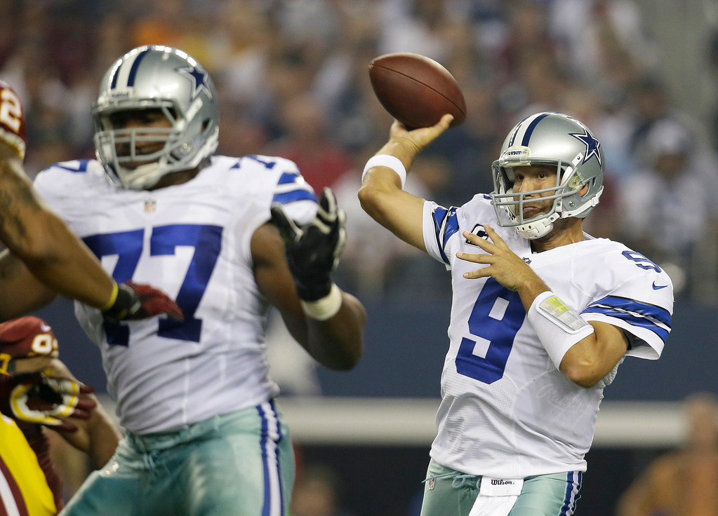 . Dallas Cowboys tackle Tyron Smith, left, helps against pressure from the Washington Redskins as quarterback Tony Romo (9) passes in the first half of an NFL football game, Sunday, Oct. 13, 2013, in Arlington, Texas. (AP Photo/Tim Sharp)