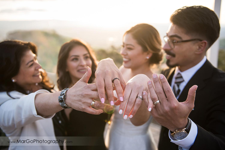 bridal party showing wedding rings at Mt Hamilton GrandView Restaurant in San Jose