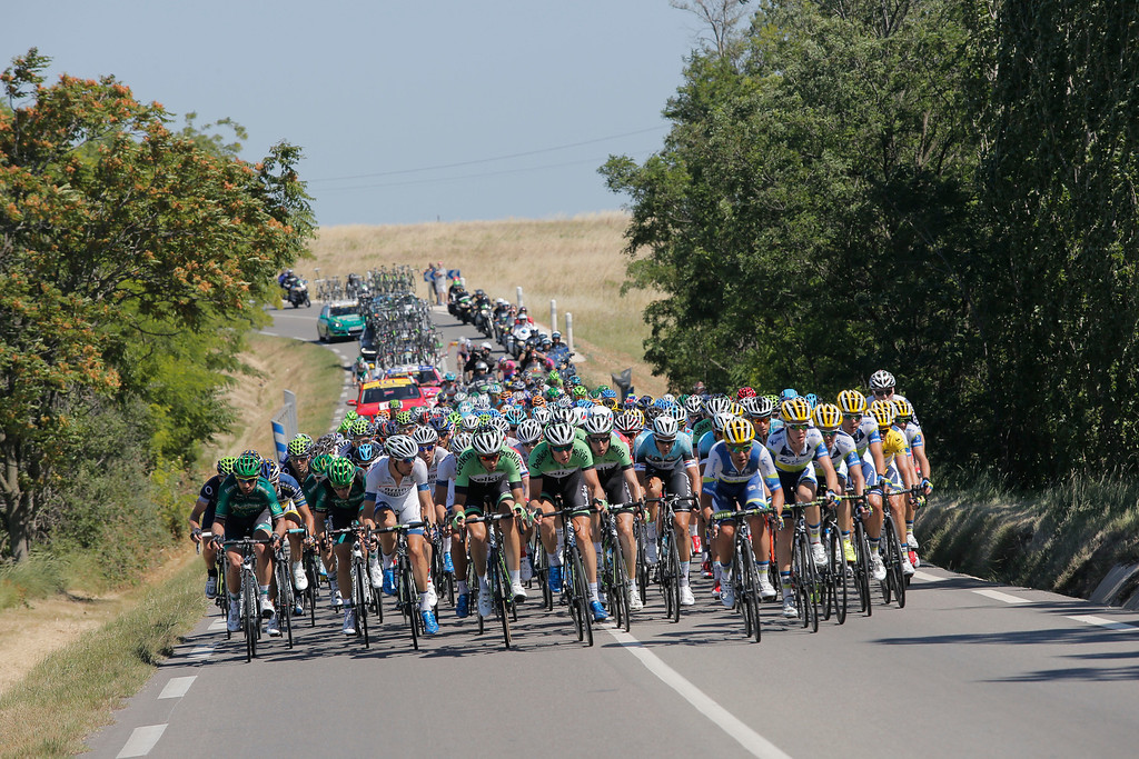 . The pack rides during the sixth stage of the Tour de France cycling race over 176.5 kilometers (110.3 miles) with start in Aix-en-Provence and finish in Montpellier, southern France, Thursday July 4, 2013. (AP Photo/Laurent Cipriani)
