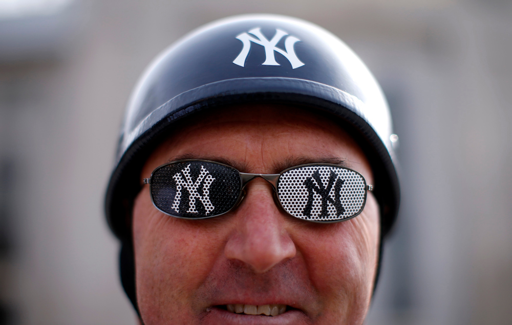 . New York Yankees fan Pete Anderson wears Yankees glasses as he stands outside Yankee Stadium before the New York Yankees opening day MLB American League baseball game against the Boston Red Sox in New York, April 1, 2013.  REUTERS/Mike Segar