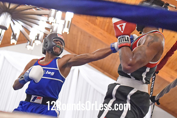 Bout 9 Terrell Ross, Cleveland -vs- Lavell Sharpe, Youngstown, 165 lbs.