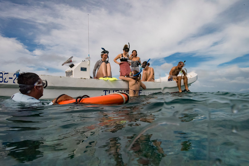 Tourists preparing for snorkeling, Turneffe Atoll, Belize Barrier Reef, Belize