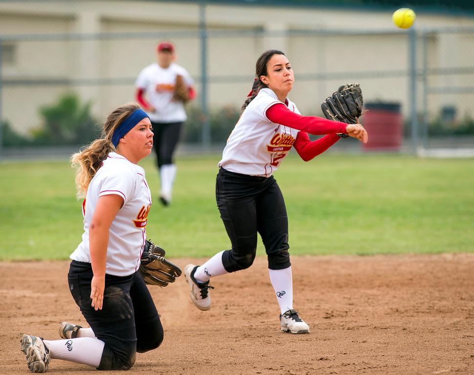 . Whittier Christian High SS Melissa Martene throws to first vs La Serna High at La Serna\'s Whittier campus field March 25, 2014.  (Staff photo by Leo Jarzomb/Whittier Daily News)
