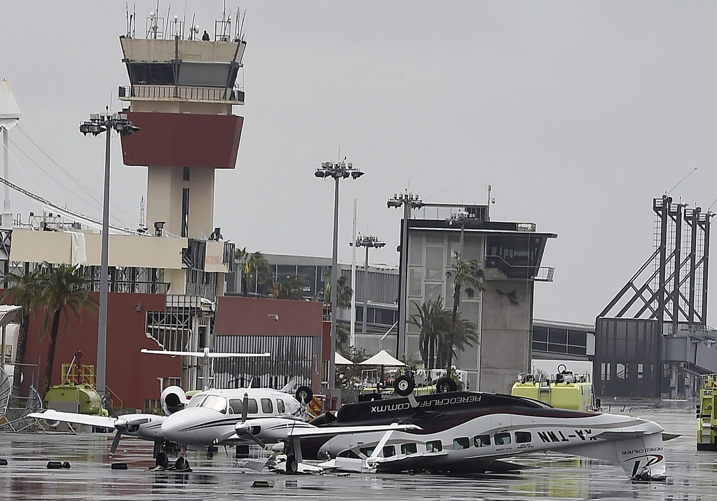 . View of damaged aircrafts at the international airport of San Jose del Cabo, on September 15, 2014 after hurricane Odile knocked down trees and power lines in Mexico\'s Baja California peninsula.  AFP PHOTO/RONALDO SCHEMIDT/AFP/Getty Images