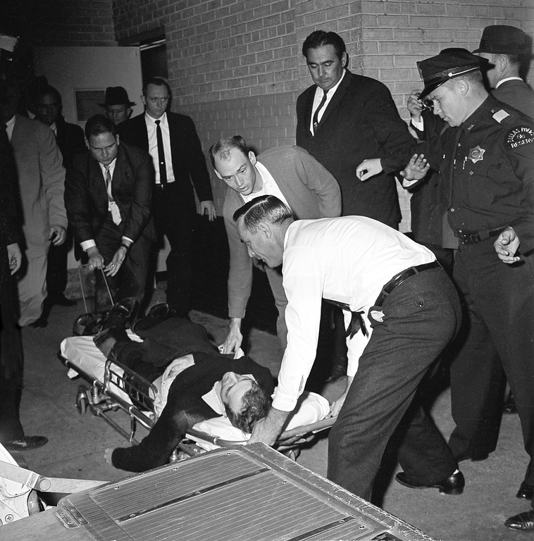 . Oswald  is placed on a stretcher after being shot in the stomach.  Ruby shot and killed Oswald as the prisoner was being transferred through the underground garage of Dallas police headquarters.  David F. Smith, Associated Press file
