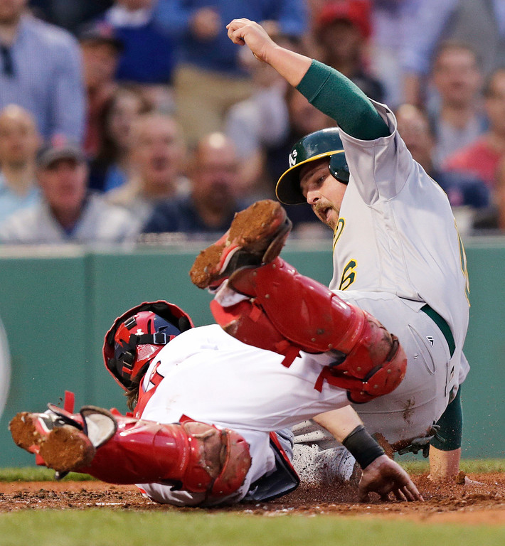 . Boston Red Sox catcher Ryan Hanigan tags out Oakland Athletics\' Billy Butler, right, while trying to score on a single by Chris Coghlan during the second inning of a baseball game at Fenway Park in Boston, Tuesday, May 10, 2016.(AP Photo/Charles Krupa)