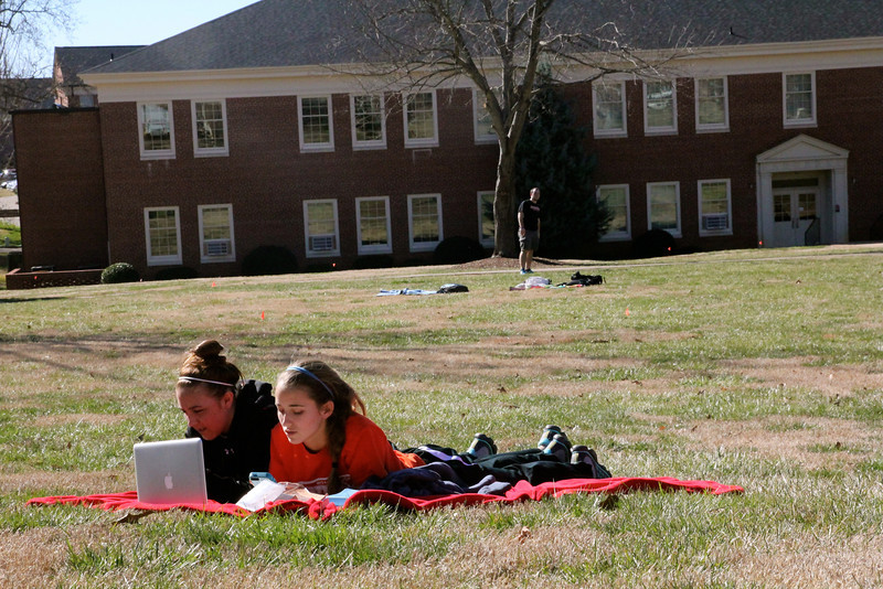 Students Addison Abee and Brooke Kelly enjoy a warm day outside on the Quad.