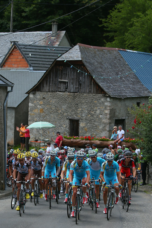 . Astana Pro Team leads the peloton as they begin the climb of the Col de Portet d\'Aspet during the sixteenth stage of the 2014 Tour de France, a 238km stage between Carcassonne and Bagneres-de-Luchon, on July 22, 2014 in Portet d\'Aspet, France.  (Photo by Doug Pensinger/Getty Images)