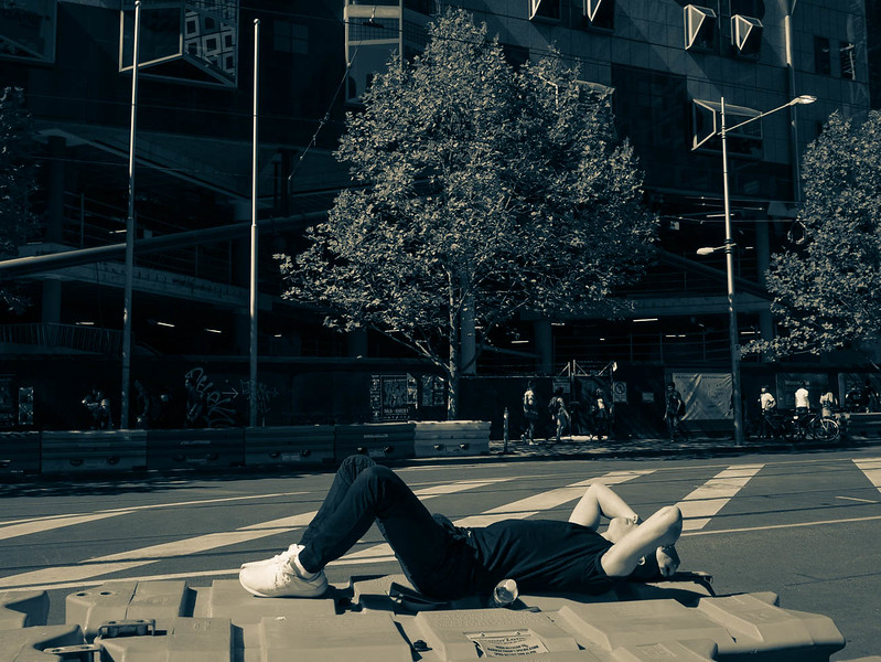Sun tanning on Swanston St.