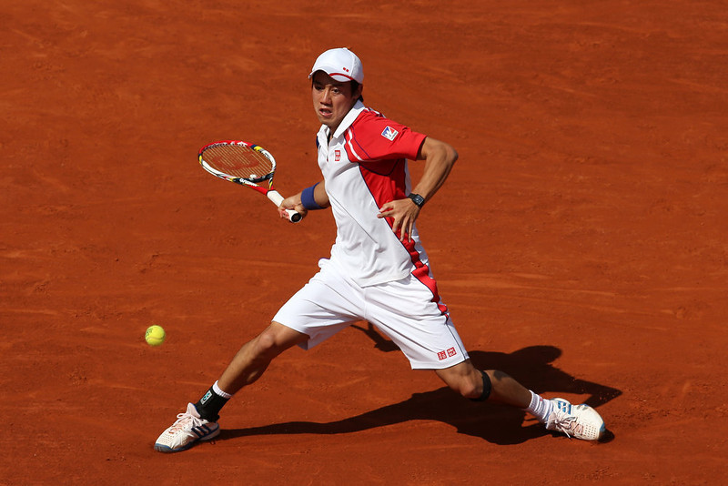 . Kei Nishikori of Japan plays a forehand during the Men\'s Singles match against Rafael Nadal of Spain during day nine of the French Open at Roland Garros on June 3, 2013 in Paris, France.  (Photo by Matthew Stockman/Getty Images)