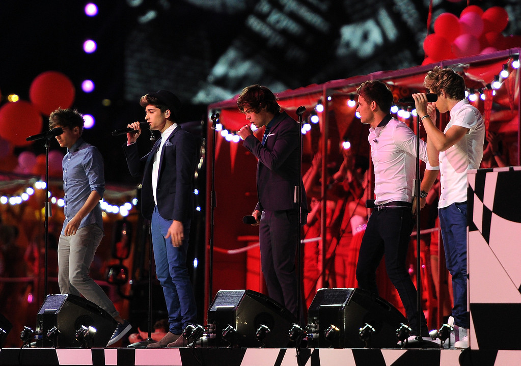 . LONDON, ENGLAND - AUGUST 12:  (L-R) Zayn Malik, Louis Tomlinson, Niall Horan, Harry Styles and Liam Payne of One Direction perform during the Closing Ceremony on Day 16 of the London 2012 Olympic Games at Olympic Stadium on August 12, 2012 in London, England.  (Photo by Pascal Le Segretain/Getty Images)