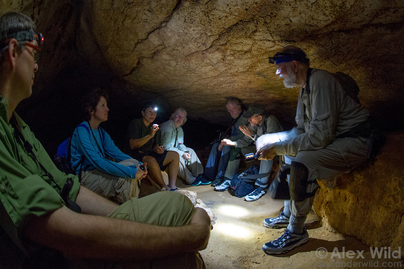 A Caves Branch guide discusses Mayan culture with a recent BugShot group during a day trip into a nearby ceremonial cave.