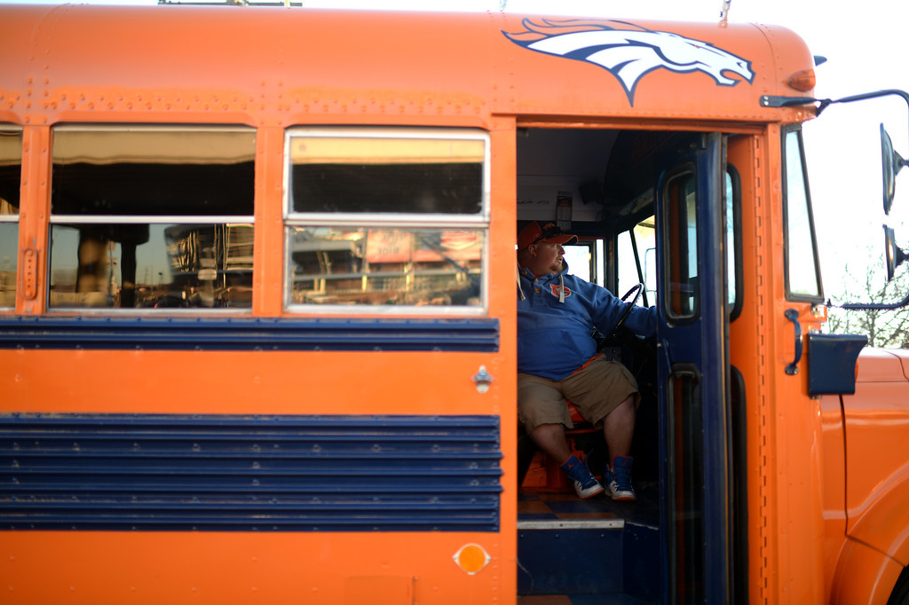 . DENVER, CO. JANUARY 18: Kevin Capbell is tailgating with the Drive, bus painted Denver Brocos team color, at the south side of Sports Authority Field at Mile High Denver. Colorado. January 18. 2014. (Photo by Hyoung Chang/The Denver Post)