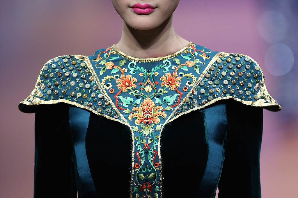 . BEIJING, CHINA - OCTOBER 25:  A model showcases designs by Zhang Zhifeng on the runway at 2014 NE-TIGER Haute Couture Collection show during Mercedes-Benz China Fashion Week Spring/Summer 2014 at Beijing Hotel on October 25, 2013 in Beijing, China.  (Photo by Feng Li/Getty Images)
