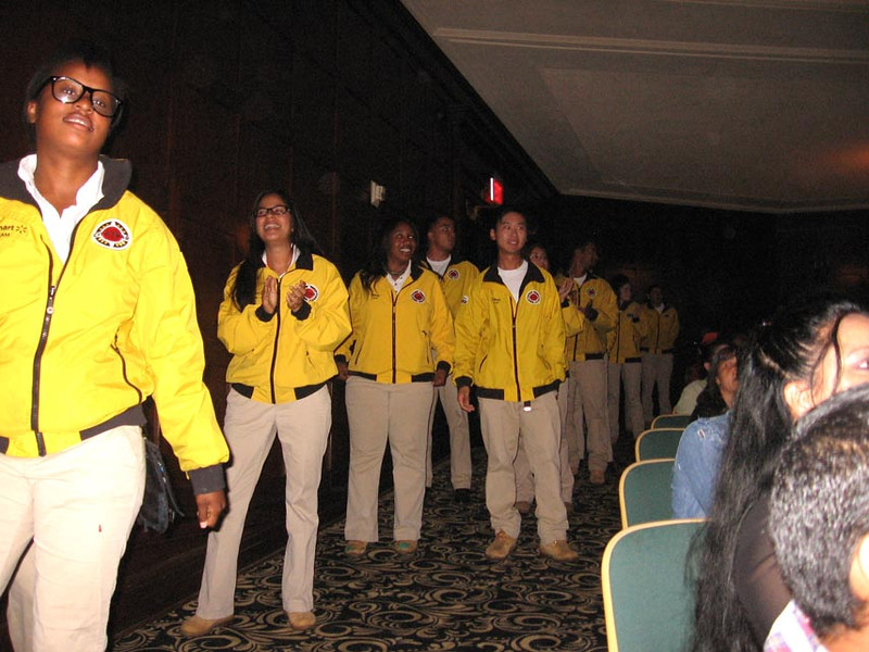 . Graduating CityYear members step up to the podium to receive their diplomas on May 31, 2013.