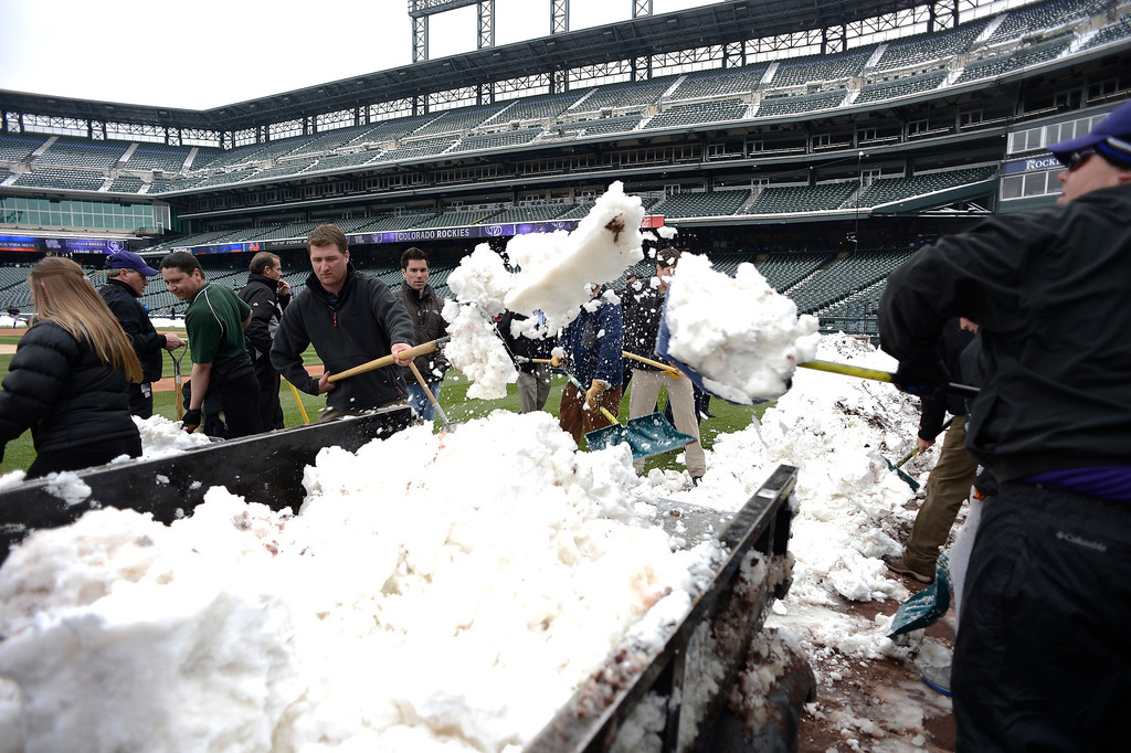 . Rockies grounds crew and employees work to clear the field of snow to get the first game of a double header in against the New York Mets April 16, 2013 at Coors Field. (Photo By John Leyba/The Denver Post)