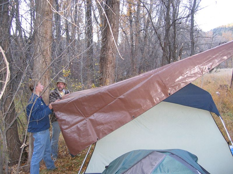 A large tarp will be sure to keep the tent's rainfly dry!