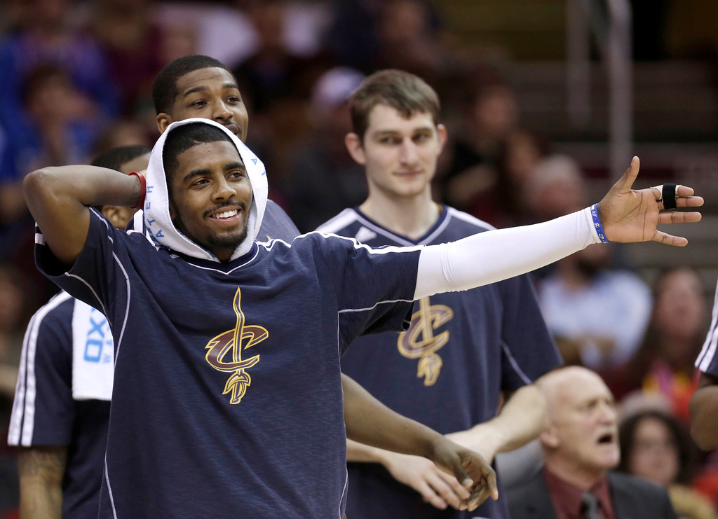 . Cleveland Cavaliers\' Kyrie Irving reacts from the bench during an NBA basketball game against the Memphis Grizzlies Friday, March 8, 2013, in Cleveland. (AP Photo/Tony Dejak)