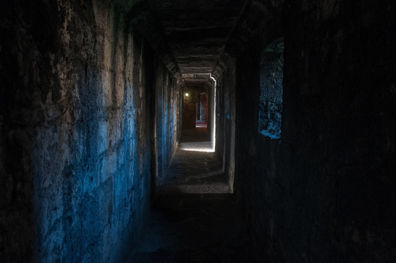 Inside the dark halls of Caernarfon Castle in Wales, England