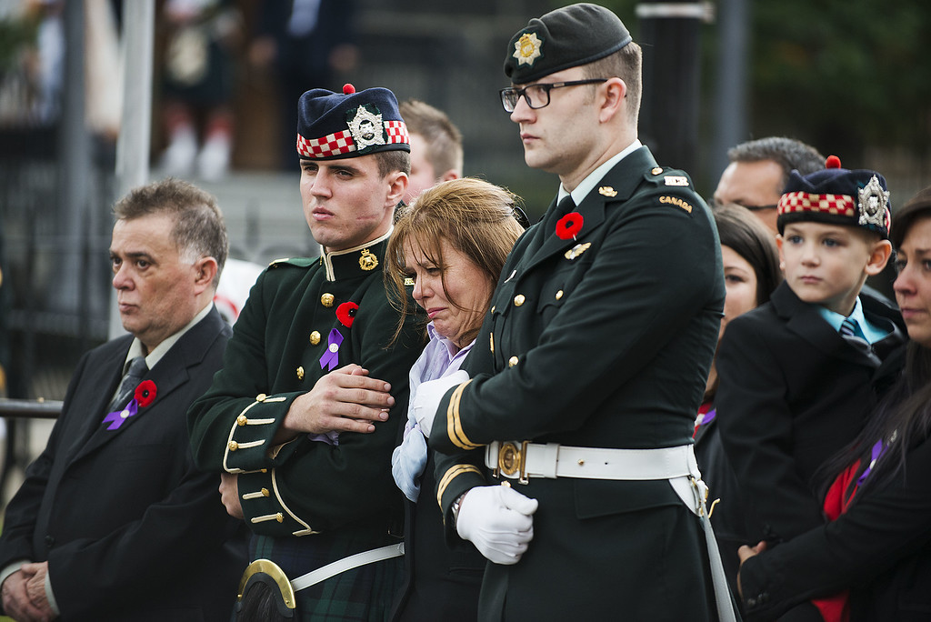 . Kathy Cirillo (3rd L),  the wife of Cpl. Nathan Cirillo Laureen Cirillo, mourns as her son Marcus Cirillo (2nd R), looks on during Nathan Cirillo\'s funeral at the Christ\'s Church Cathedral on October 28, 2014 in Hamilton, Ontario, Canada.  (Photo by Aaron Vincent Elkaim/Getty Images)