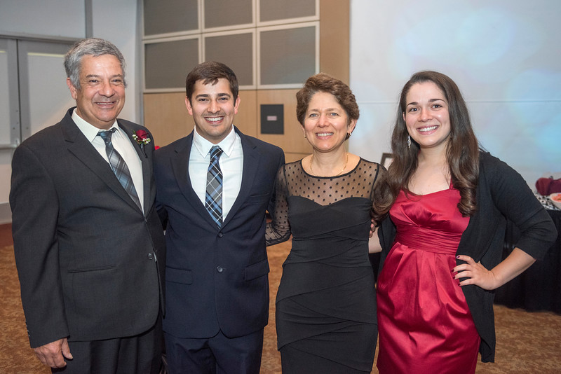 Jose Manuel Leal da Costa (left), family, guests and honorees enjoy the Distinguished Alumni Dinner on Friday, March 24, 2017 in Chico, Calif. (Jason Halley/University Photographer)