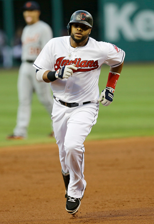 . Cleveland Indians\' Carlos Santana runs the bases after hitting a two-run home run off Detroit Tigers starting pitcher Justin Verlander in the first inning of a baseball game, Wednesday, Sept. 3, 2014, in Cleveland. Jose Ramirez also scored on the play. (AP Photo/Tony Dejak)