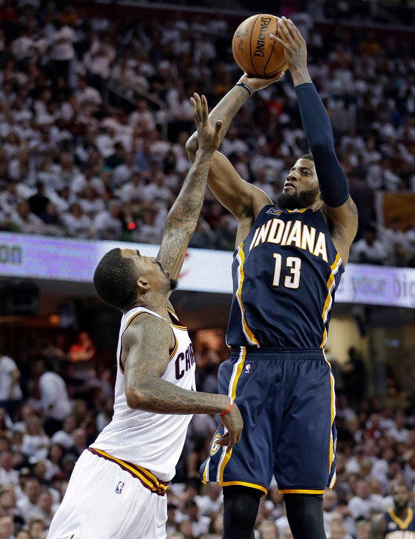 . Indiana Pacers\' Paul George (13) shoots over Cleveland Cavaliers\' J.R. Smith (5) in the second half in Game 1 of a first-round NBA basketball playoff series, Saturday, April 15, 2017, in Cleveland. (AP Photo/Tony Dejak)