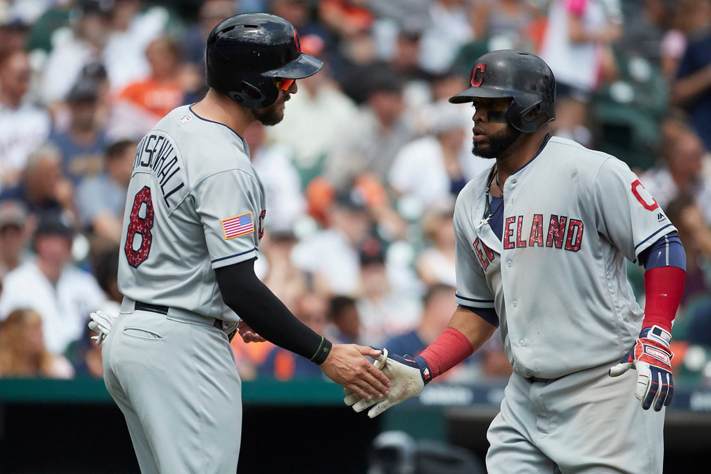 . Cleveland Indians Carlos Santana receives congratulations from Lonnie Chisenhall (8) after he hits a two run home run in the seventh inning against the Detroit Tigers in the first baseball game of a doubleheader in Detroit, Saturday, July 1, 2017. (AP Photo/Rick Osentoski)