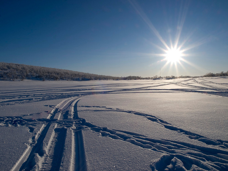 Sunburst on frozen lake at back of camp.