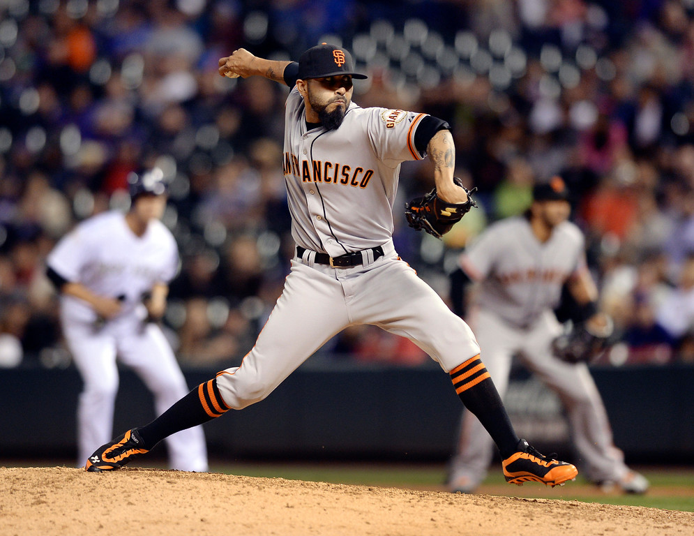 . Giants reliever Sergio Romo pitched in the ninth inning with a runner on first base. Colorado batter Nolan Arenado doubled to drive in two runs in the bottom of the ninth inning.   (Photo by Karl Gehring/The Denver Post)