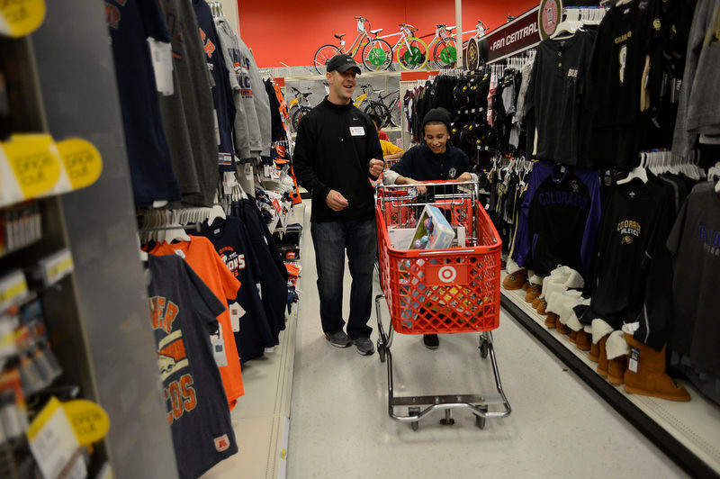 . Broncos wide receiver Brandon Stokely shops with Jose during his shopping spree at Target. Eric Decker and Demaryius Thomas and other teammates reached out to help children in their community by hosting a holiday shopping trip at Super Target Tuesday, December 11, 2012 in Lone Tree. 25 children, ranging in age from 8 to 14, are being rewarded for their outstanding participation in their after-school program with a trip to buy holiday presents. John Leyba, The Denver Post