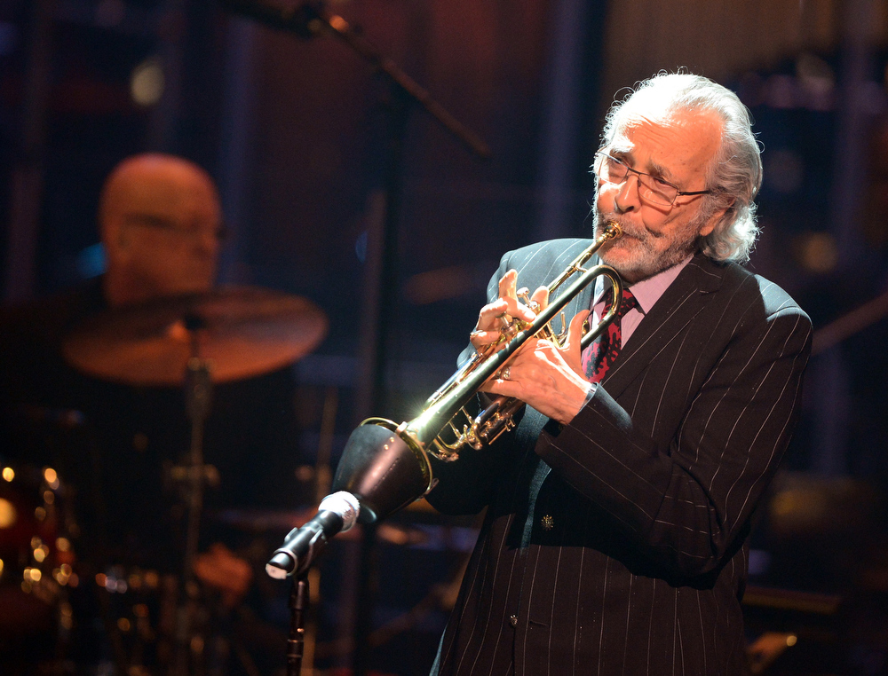 Description of . Herb Alpert performs onstage during a celebration of Carole King and her music to benefit Paul Newman's The Painted Turtle Camp at the Dolby Theatre on December 4, 2012 in Hollywood, California.  (Photo by Michael Buckner/Getty Images for The Painted Turtle Camp)