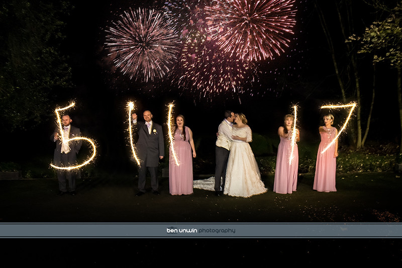 Professional wedding photographer with fireworks