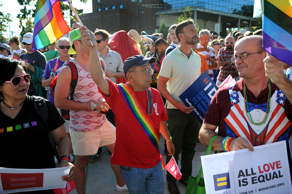 . People attend a rally in West Hollywood to celebrate the U.S. Supreme Court\'s ruling that killed Prop 8, Wednesday, June 26, 2013. (Michael Owen Baker/L.A. Daily News)