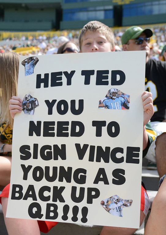 . Philip Gutting of Green Bay, Wis. has a message for general manager Ted Thompson at the Packers annual shareholders meeting at Lambeau Field. (AP Photo/The Green Bay Press-Gazette, H. Marc Larson)