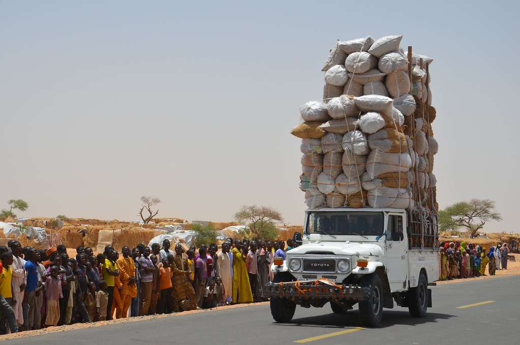 ". An overloaded car travels through the Assaga refugee camp in Diffa on May 17, 2016, close to the Niger-Nigeria border.  Chief of Humanitarian Operations of the UN, Stephen O\'Brien, vowed on May 17 to raise funds at the next World Humanitarian Summit for ""significant\"" help to the more than 240,000 refugees displaced by Boko Haram in camps in south-east Niger. / AFP PHOTO / BOUREIMA  HAMA/AFP/Getty Images"