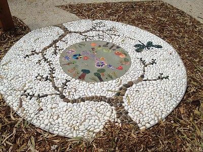 inlaid pebble and children's artwork circle