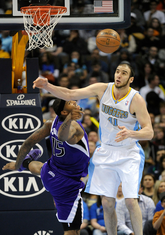 . DENVER, CO. - MARCH 22: DeMarcus Cousins (15) of the Sacramento Kings and Kosta Koufos (41) of the Denver Nuggets competed for a rebound in the second half. The Denver Nuggets defeated the Sacramento Kings 101-95 Saturday night, March 23, 2013 at the Pepsi Center. The Nuggets extended its longest winning streak since joining the NBA to 15 games with the win over the Kings. (Photo By Karl Gehring/The Denver Post)