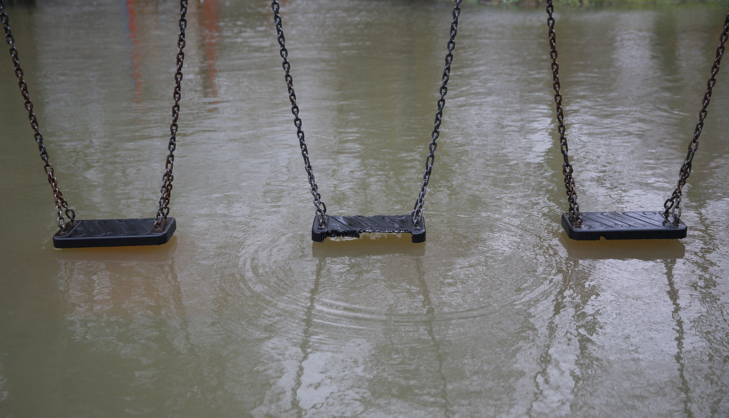 . River Thames floodwater reaches a children\'s playground on February 11, 2014 in Wraysbury, England. The Environment Agency has issued severe flood warnings for a number of areas on the river Thames west of London. Thousands of homes are under threat and may have been evacuated. (Photo by Peter Macdiarmid/Getty Images)