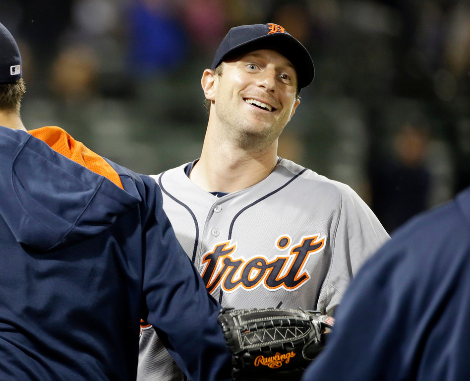 . Detroit Tigers starter Max Scherzer smiles as he celebrates with teammates after the Tigers defeated the Chicago White Sox 4-0 in a baseball game in Chicago on Thursday, June 12, 2014. (AP Photo/Nam Y. Huh)